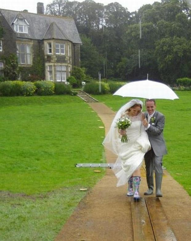 Nicky Patrick and Kerry Simmance in their wellies on their wedding day