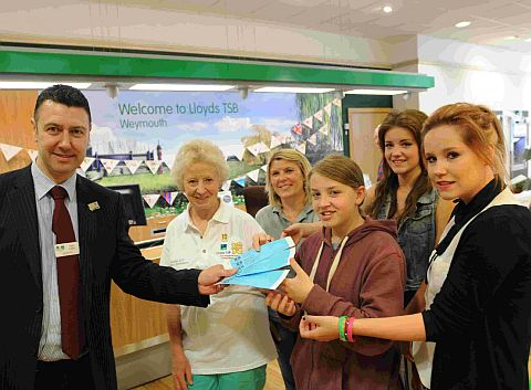Paul Larter of Lloyds TSB hands tickets to Di Ludlow, Kerry Knight and sisters Louise, Michelle and Nikki Taylor