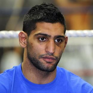 Amir Khan, pictured, would need to move up a division to fight Floyd Mayweather