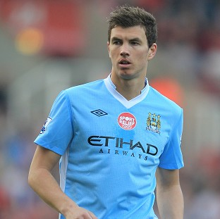 Manchester City have quashed rumours linking Edin Dzeko with AC Milan
