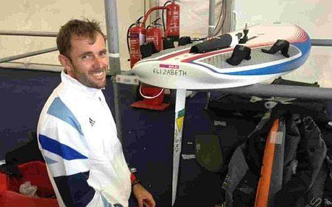 SMASH IT, DEMPO: Weymouth's Olympic windsurfer Nick Dempsey with his new board called Elizabeth, named after the Queen