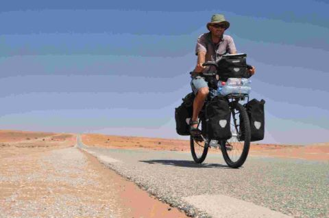 PEDAL POWER: Peter Gostelow cycling through the Sahara on his charity bike ride from Dorset to Cape Town, South Africa