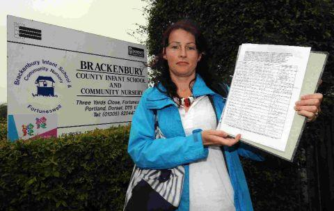 Lisa Hughes with a previous petition outside Brackenbury School