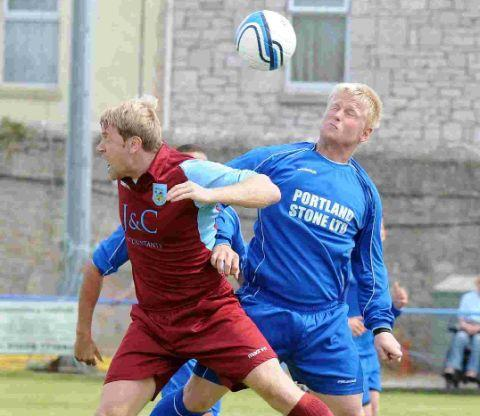 AERIAL BATTLE: Weymouth forward Matt Groves competes in the air with Blues' ace Lewis Whyton at Grove Corner on Saturday
