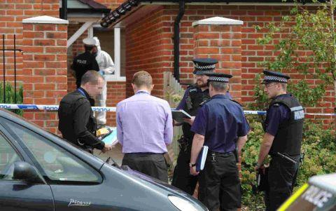 Police officers at the flat in Benville Road, Weymouth