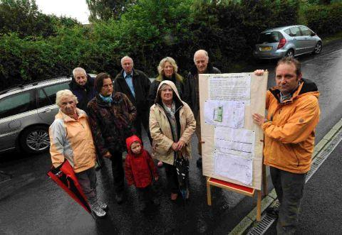 WE'RE ANGRY: Ed Richards, right, with residents