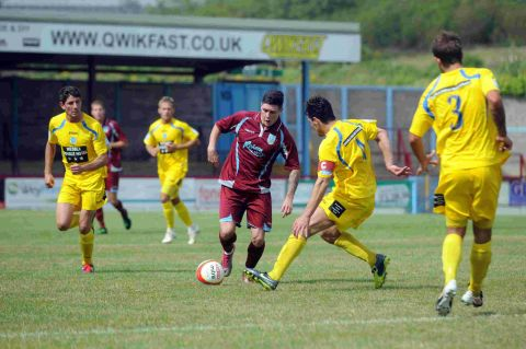DERBY BATTLE: Weymouth's Dan Smith is closed down by Magpie Mark Jermyn