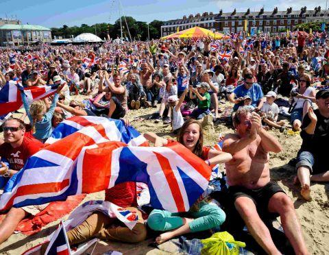 Dorset Echo: CELEBRATION: Happy scenes at the Live site on Weymouth beach