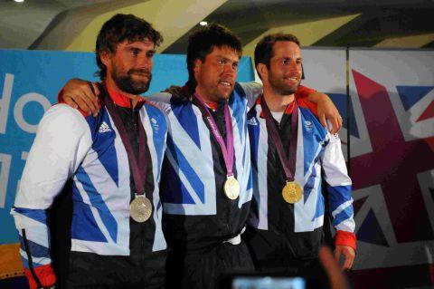 Iain Percy, Andrew Simpson and Ben Ainslie with their Olympic medals