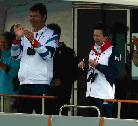 Princess Anne and her husband Tim Lawrence applaud as Ainslie clinches his fourth Olympic gold