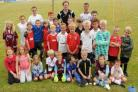BUDDING FOOTBALLERS: Youngsters with Scott Dixon and coaches at the soccer school