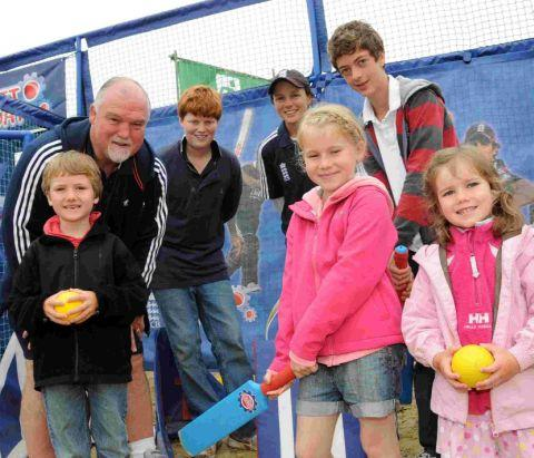 Ex-England cricketer Mike Gatting and womens England cricketer Caroline Atkins at the Weymouth Beach sports arena with children taking part in the cricket taster