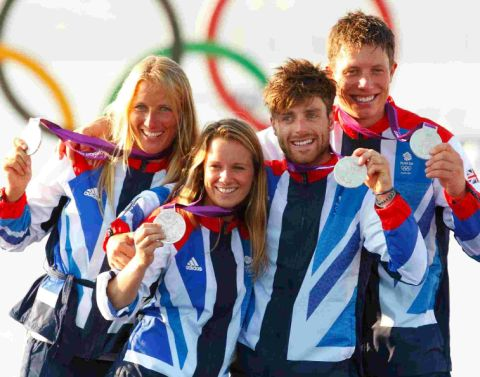 SHOW US YOUR MEDALS: Silver medal winners in the 470 class Saskia Clark, left, and Hannah Mills with Luke Patience and Stuart Bithell, far right