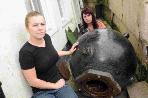 Jo Evans and Emma Brooks with the money collection sea mine