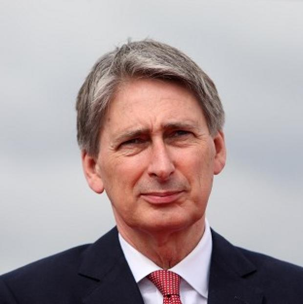 Dorset Echo: Defence Secretary Philip Hammond said top-level military job cuts will save the MoD nearly 4m pounds a year