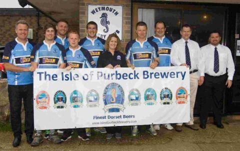 CHEERS: Members and supporters of Weymouth Rugby Club promote the Great Weymouth Beer Festival