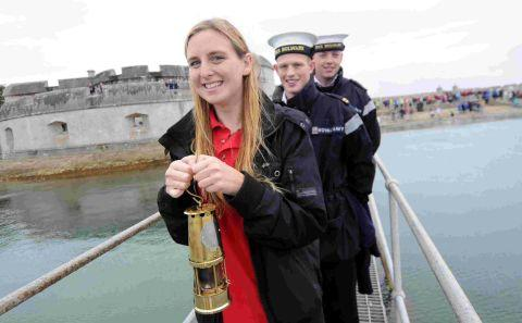 Maria Lochrie carries the Flame at Portland