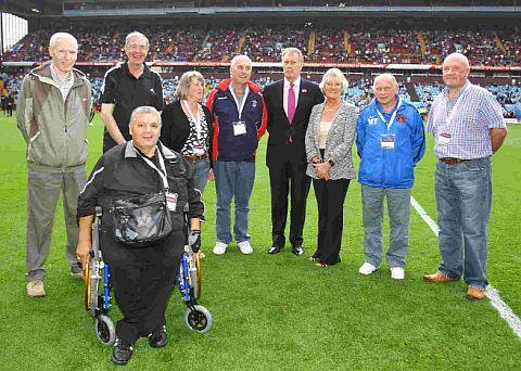 MOWLEM'S PRIDE: Bob Mowlem, second left, lines up alongside ex-England ace Sir Geoff Hurst, fourth right, during a presentation at the FA Community Shield at Villa Park