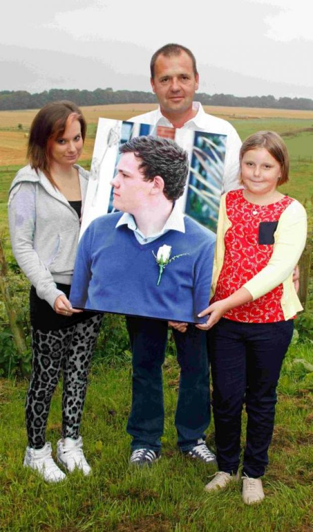 Dorset Echo: FRIENDS AND FAMILY: Laura Haskell with Ben's father Paul Andrews and his daughter Molly, 9, holding a favourite photograph of Ben