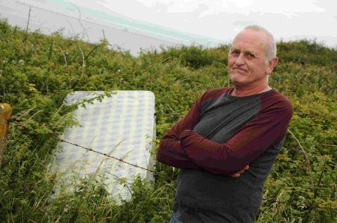 Raymond Berkhauer is upset at the flytipping near his house