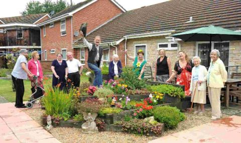 GOING GREEN: Winner Alan Horwood and residents at Crossways Court