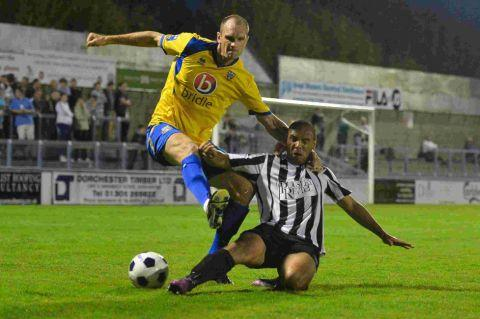 SLIDING CHALLENGE: Magpie Ashley Nicholls closes down Eastleigh defender Tom Jordan