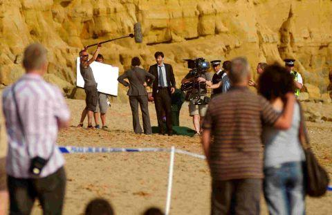ACTION: Actor David Tennant filming on East Beach, West Bay