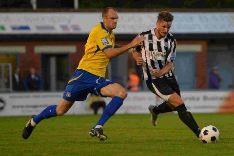 HAILED: Midfielder Jamie Gleeson, right