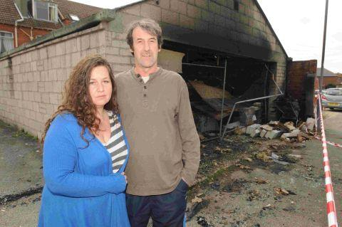 ARSON ATTACK:  Hannah Webster and Geoff Wick outside the burnt out garage in Westham, Weymouth