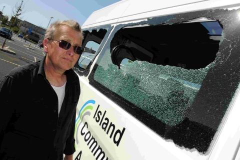 SHATTERED: Benjamin Scott with the vandalised Island Community Action minibus