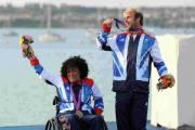 Alex Rickham and Niki Birrell with their bronze medals at the sailing academy