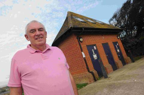 CHAIN REACTION:  Councillor Geoff Petherick with the disused toilets on Portland Road, Wyke Regis