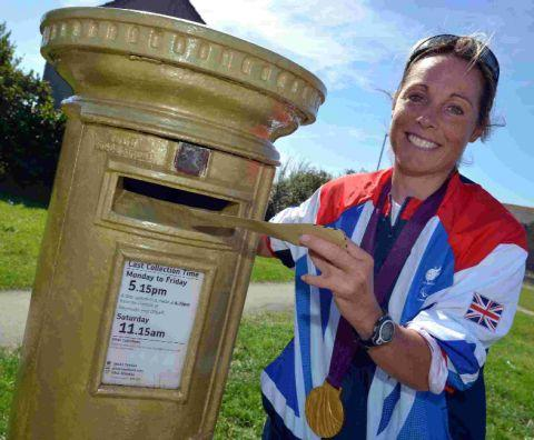 Dorset Echo: FIRST CLASS: Helena Lucas with the gold post box