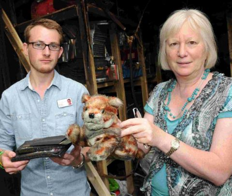 Matt Smith and Caroline Nickinson with fire-damaged items which were destined for the Joseph Weld fete