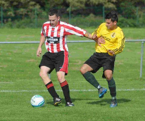 PROTECTION: Ross Connor, left, keeps a Wincanton defender at arm's length