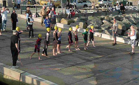 ON YOUR MARKS: Swimmers get ready for the New Delapre