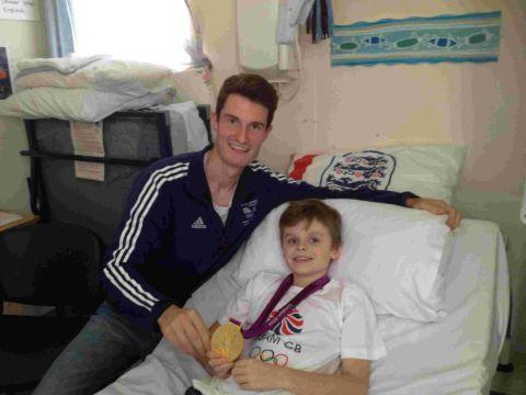 Samuel 'Sammy Jim' Clark, aged ten from Bridport with Olympic gold medallist Peter Wilson at Dorset County Hospital