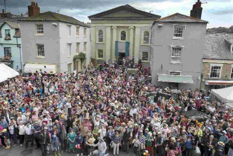 FULL TO THE BRIM: Hat wearing festival goers in Bridport last year