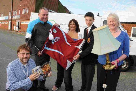 SO KIND: Grant Usmar of Weldmar, Iain Stone of Weymouth FC, Fiona Wisher, Ryan Wisher and Caroline Nickinson of Weldmar