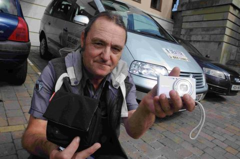 KIND CABBIE: Taxi driver Martin Mills with the lost camera