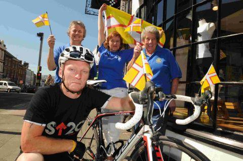 CYCLE STARS: Tom Pattinson-Smith and Ros Fry, back centre, are cycling for charity pictured with  Rotary Club members Debbie Dunford, left, and Lar Smits