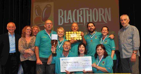Dorset Echo: CHEERS FOR BLACKTHORN: Motley Crew with last year's runners-up trophy