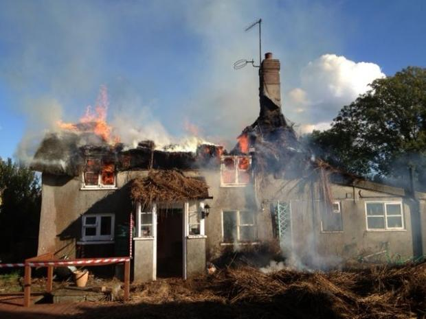 Dorset Echo: The fire at Hurst Cottage at Morton. Picture: Dorset Fire and Rescue Service