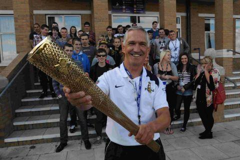 INSPIRATION: Torchbearer Tim Ellis takes his torch to Weymouth College to help raise funds for Weldmar