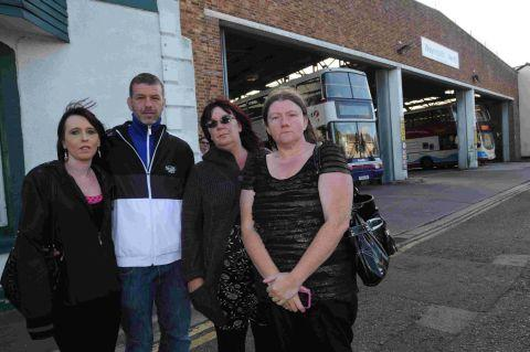 NOT FARE: Angry parents Tracey Puckett, Mark Videan, Karen Stone and Jackie Isbell at Weymouth bus garage