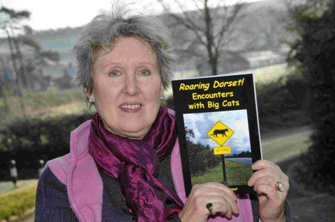 EXPERT: Author Merrily Harpur with her book on big cat sightings in Dorset