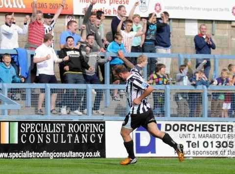 MAGPIES' SALUTE: Ben Watson celebrates with the Avenue faithful after scoring
