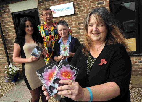 BINDING DEAL: Anita Harries, with from left, Tracey Limm, the owner of Studio Print, sponsor and town councillor Tim Harries and Pam Burch of Studio Print
