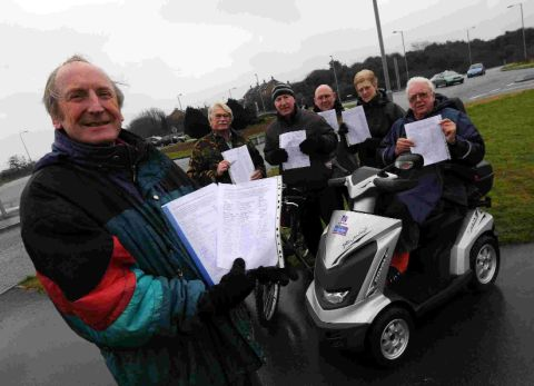 CROSSING CAMPAIGN: Coun David Harris and supporters and petitions at Chafey's roundabout