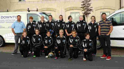 BOUNCING BACK: Dorchester Town Raiders Girls Under-14s with their new tracksuits, which have been sponsored by S&R Downton